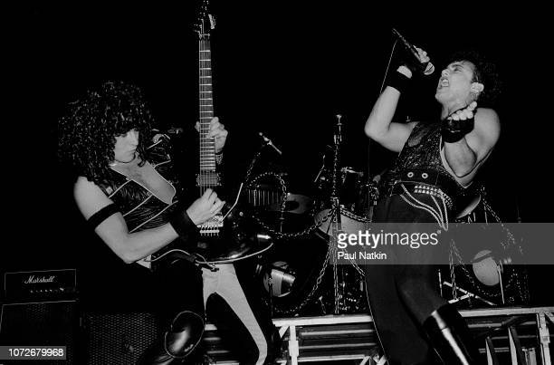 Guitarist Michael Wilton, left, and singer Geoff Tate of Queensryche perform at the Milwaukee Arena in Milwaukee, Wisconsin, December 30, 1984.
