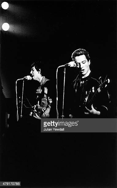 Guitarist Mick Jones and singer Joe Strummer performing with British punk group The Clash at the Coliseum, Harlesden, London, 11th March 1977.