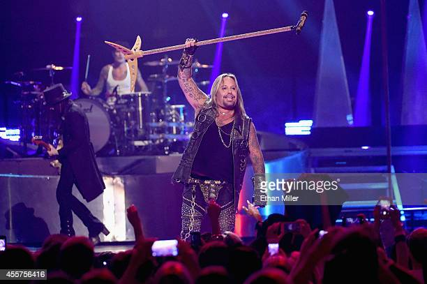 Guitarist Mick Mars drummer Tommy Lee and singer Vince Neil of Motley Crue perform onstage during the 2014 iHeartRadio Music Festival at the MGM...