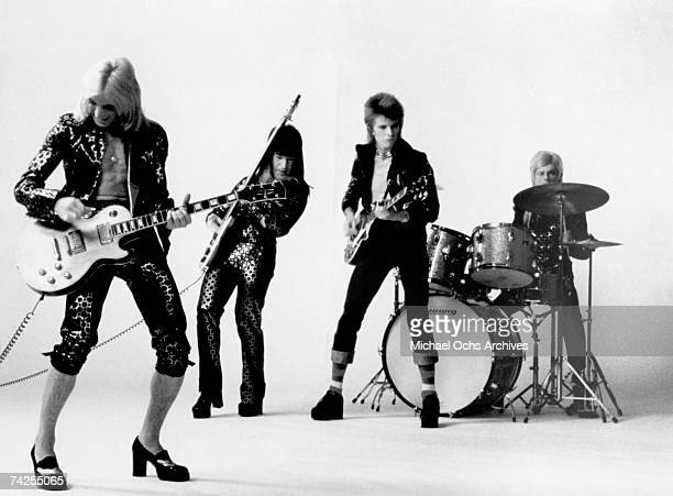 Guitarist Mick Ronson bassist Trevor Bolder David Bowie and drummer Mick Woodmansey of Ziggy Stardust And The Spiders From Mars pose for a portrait...