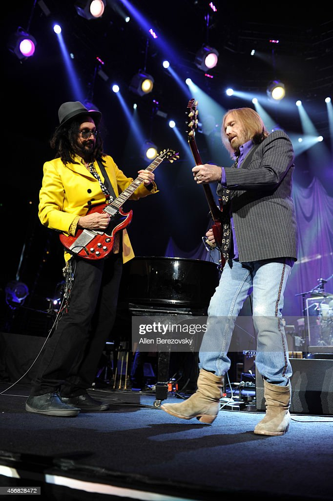 Guitarist Mike Campbell (L) and Tom Petty of Tom Petty and The Heartbreakers perform at Honda Center on October 7, 2014 in Anaheim, California.