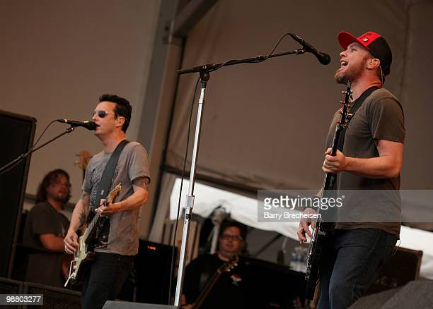Guitarist Mike McCready and bassist Jeff Ament of Pearl Jam perform during Day 6 of the 41st annual New Orleans Jazz & Heritage Festival at the Fair...