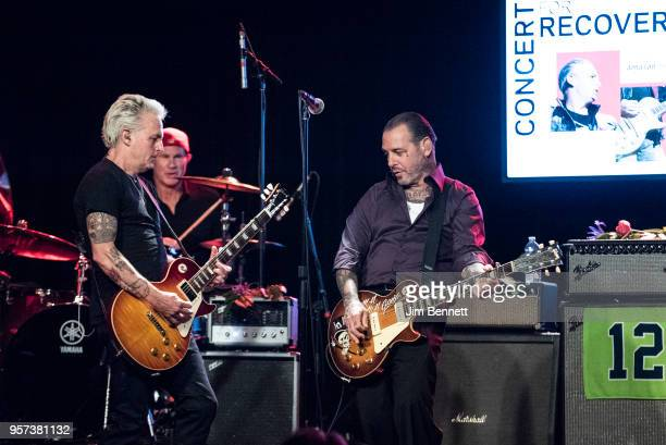 Guitarist Mike McCready drummer Chad Smith and guitarist and singer Mike ness perform live on stage during the MusiCares Concert for Recovery benefit...
