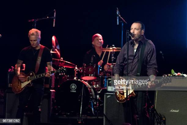 Guitarist Mike McCready drummer Chad Smith and singer and guitarist Mike Ness perform live on stage during the MusiCares Concert for Recovery benefit...