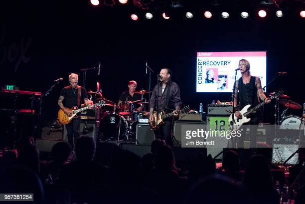 Guitarist Mike McCready drummer Chad Smith guitarist and singer Mike Ness and bassist Duff McKagan perform live on stage during the MusiCares Concert...