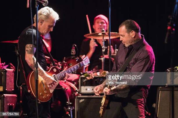 Guitarist Mike McCready of Pearl Jam Drummer Chad Smith of Red Hot Chili Peppers and Singer Mike Ness of Social Distortion perform on stage during...