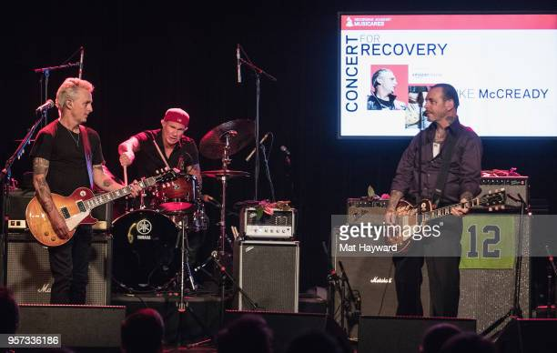 Guitarist Mike McCready of Pearl Jam Drummer Chad Smith of Red Hot Chili Peppers and Mike Ness of Social Distortion perform on stage during the...
