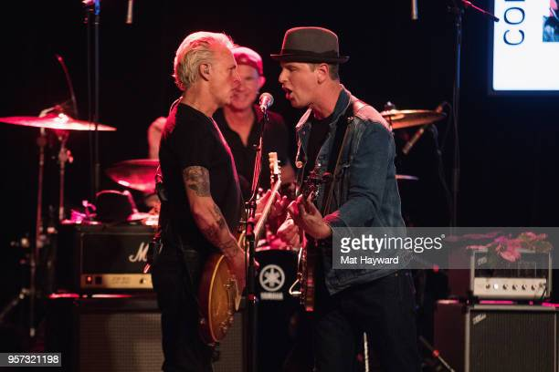 Guitarist Mike McCready of Pearl Jam drummer Chad Smith of the Red Hot Chili Peppers and Danny Newcomb perform on stage during the MusiCares Concert...