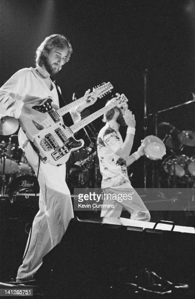 Guitarist Mike Rutherford and singer Phil Collins performing with Genesis at the Manchester Apollo 19th April 1980