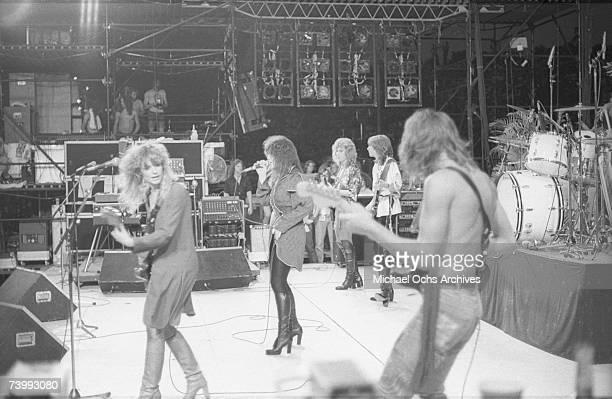 Guitarist Nancy Wilson singer Ann Wilson guitarist Howard Leese guitarist Roger Fisher bassist Steve Fossen and drummer Michael Derosier of the rock...
