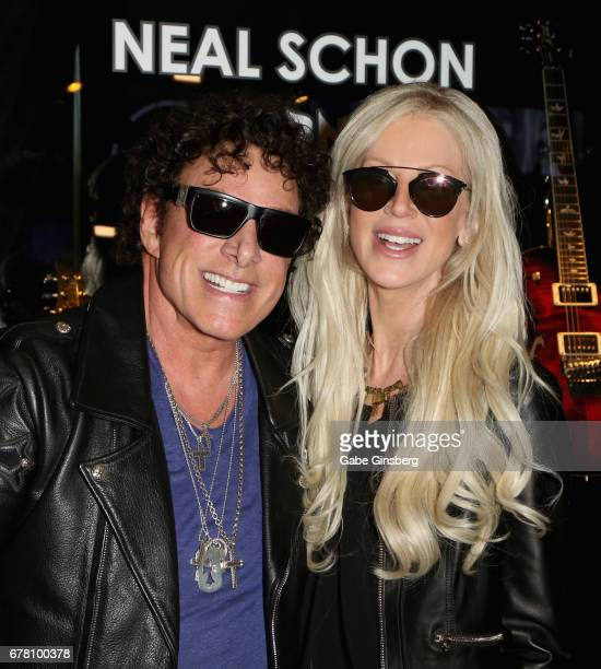 Guitarist Neal Schon of Journey and his wife television personality Michaele Schon attend a memorabilia case dedication for Neal Schon at the Hard...