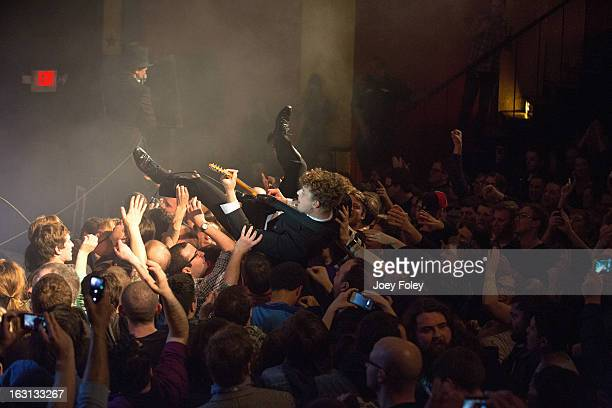 Guitarist Nicholaus Arson of The Hives goes crowd surfing as his band performs onstage at The Vogue on March 4 2013 in Indianapolis Indiana