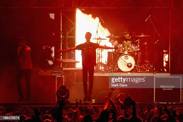Guitarist Nick Tsang Drummer Matthew Curtis and Singer Josh Friend of Modestep perform onstage during day 1 of the 2013 Coachella Valley Music Arts...