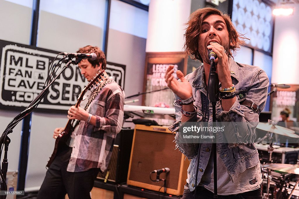 Guitarist Nick Wheeler (L) and Tyson Ritter of The All-American Rejects perform live at the MLB Fan Cave on September 10, 2012 in New York City.