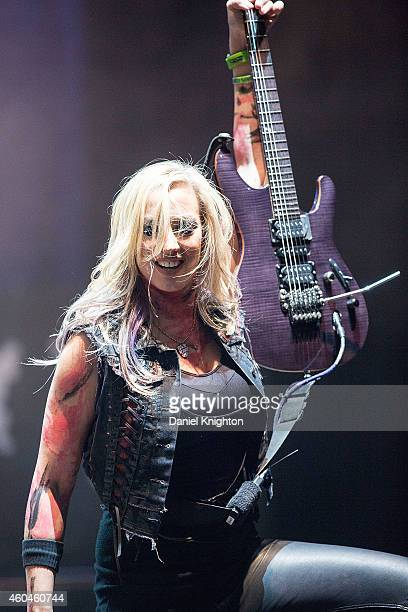 Guitarist Nita Strauss performs on stage during the 14th annual Christmas Pudding Charity concert at Comerica Theatre on December 13 2014 in Phoenix...