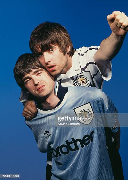 Guitarist Noel Gallagher and his brother singer Liam Gallagher of British rock group Oasis in Portsmouth 9th May 1994 Both are sporting Manchester...