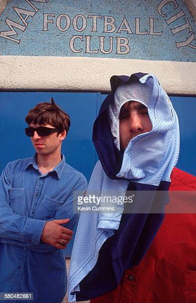 Guitarist Noel Gallagher and his singer brother Liam Gallagher of British rock band Oasis at Manchester City's Maine Road stadium Manchester 2nd...