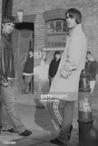 Guitarist Noel Gallagher and singer Liam Gallagher of Manchester rock band Oasis outside the London offices of their record label Creation with other...