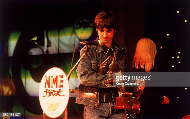 Guitarist Noel Gallagher of Manchester rock band Oasis with the group's four awards at the NME Brat Awards held in London 1996 Oasis won the awards...