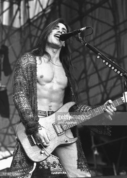 """Guitarist Nuno Bettencourt is shown performing on stage during a """"live"""" concert appearance with Extreme on July 2, 1991."""