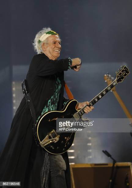 Guitarist of British band the Rolling Stones Keith Richards performs with the band during the inauguration concert of the U Arena hall new stadium of...