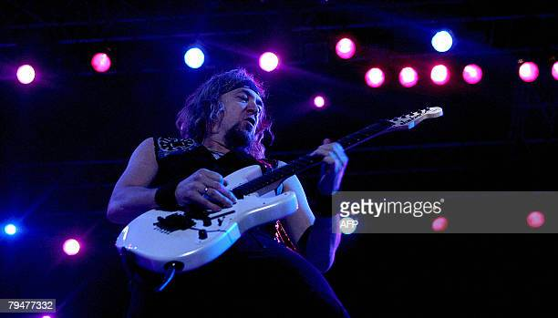 Guitarist of British rock group Iron Maiden Adrian Smith performs during a concert in Mumbai late 01 February 2008 The sixmember band started their...