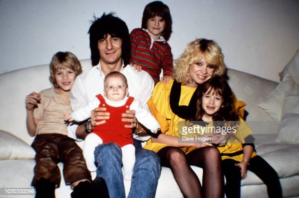 Guitarist of The Rolling Stones, Ronnie Wood and wife Jo Wood are photographed with their children in Chelsea, London in 1983.