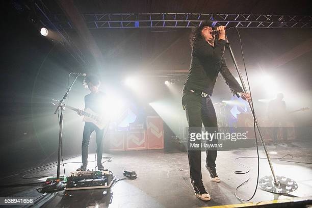 Guitarist Omar Rodriguez Lopez and singer Cedric BixlerZavala of At The Drive In performs onstage at Showbox SoDo on June 8 2016 in Seattle Washington