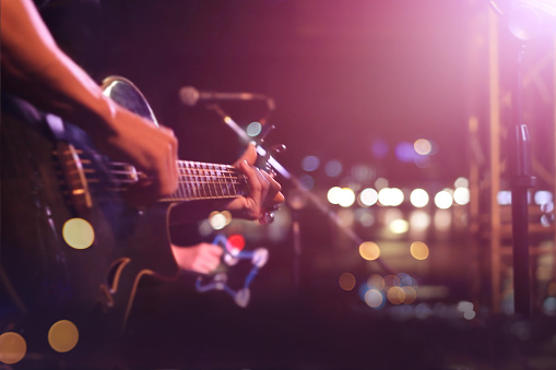 Guitarist on stage for background, soft and blur concept 499580590