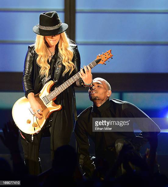 Guitarist Orianthi and singer Chris Brown perform onstage during the 2013 Billboard Music Awards at the MGM Grand Garden Arena on May 19 2013 in Las...