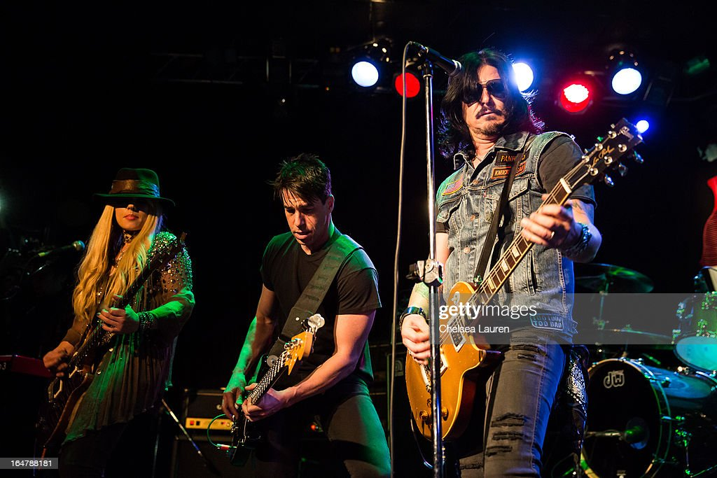 Guitarist Orianthi of Alice Cooper, bassist Phil Buckman of Filter and musician Gilby Clarke perform at the Rock Against MS benefit concert at The Whisky a Go Go on March 27, 2013 in West Hollywood, California.