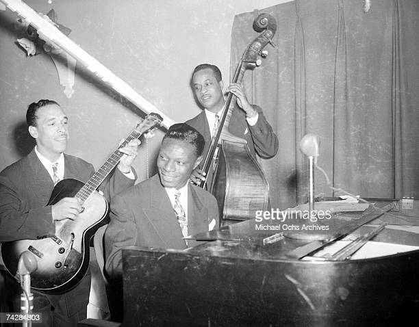 guitarist Oscar Moore pianist Nat 'King' Cole and bassist Johnny Miller of the Nat 'King' Cole Trio record in Capitol Records studios on December 15...