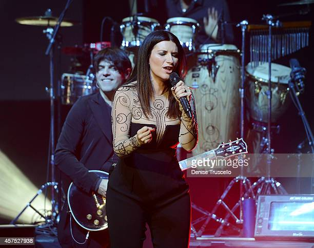 Guitarist Paolo Carta and Laura Pausini perform at the Pearl at Palms Casino Resort on October 19 2014 in Las Vegas Nevada
