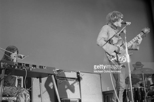 Guitarist Paul Kantner and Grace Slick of the rock group Jefferson Airplane rehearse for a concert at Hunter College on October 20 1967 in New York...