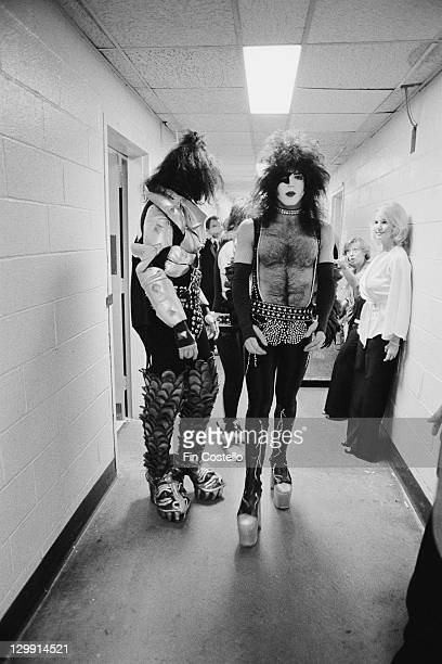 Guitarist Paul Stanley and bassist Gene Simmons of American heavy metal group Kiss backstage circa 1975
