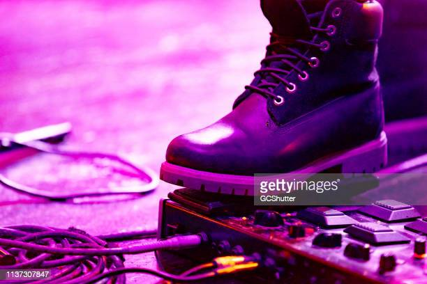 guitarist performing at the concert - pedal stock pictures, royalty-free photos & images