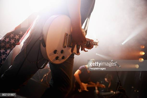 in tune with his guitar - pop rock stock pictures, royalty-free photos & images