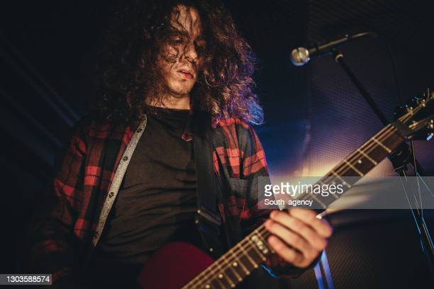 guitarist performing on stage - pop musician stock pictures, royalty-free photos & images