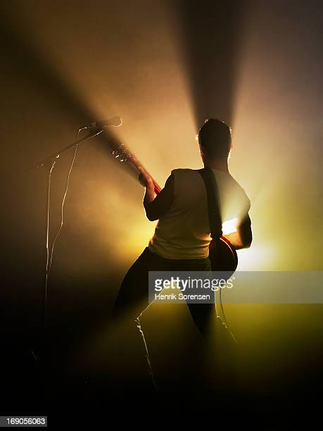 guitarist performing on stage - guitarist stock pictures, royalty-free photos & images