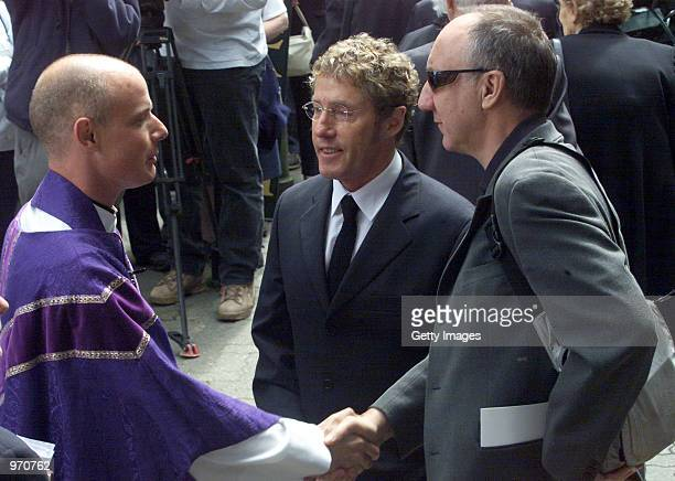 Guitarist Pete Townshend and Singer Roger Daltrey thank the Rector Colin Wilson after he conducted the funeral service for John Entwistle at St...