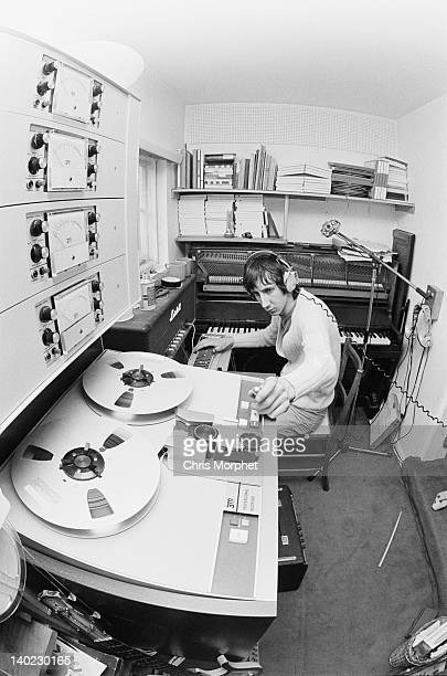 Guitarist Pete Townshend of The Who, in the recording studio at his home in Twickenham, London, 1969. In the background is a Bechstein upright piano.