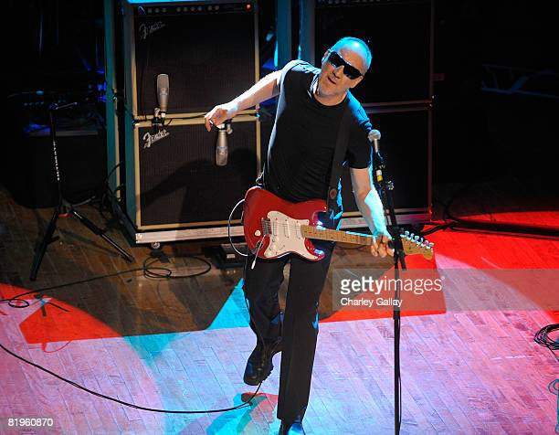 Guitarist Pete Townshend of The Who performs a surprise concert during the Harmonix and MTV Games Rock Band Party at the Orpheum Theater on July 16...