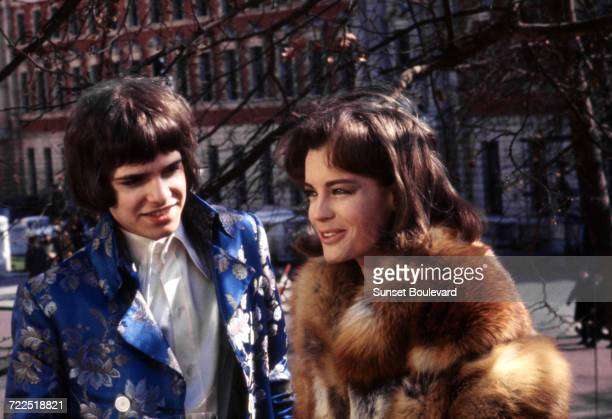 Guitarist Peter Frampton of English pop group The Herd with actress Romy Schneider on the set of 'Otley' directed by Dick Clement London 1968