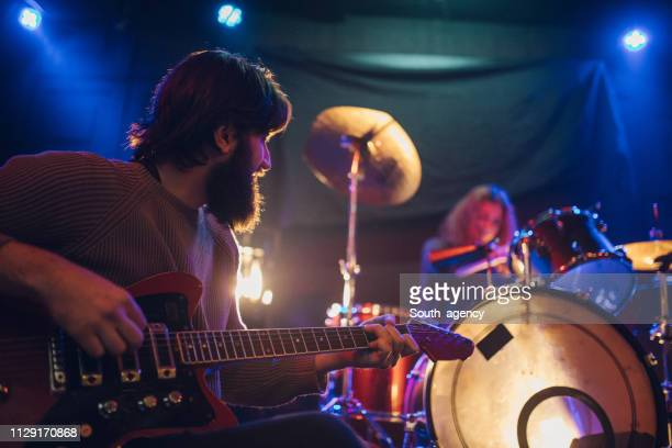 guitarist - pop rock stock pictures, royalty-free photos & images