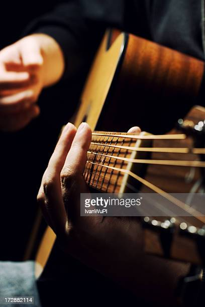 guitarist - acoustic guitar stock pictures, royalty-free photos & images