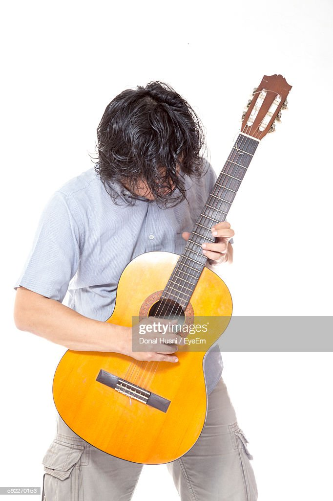 Guitarist Playing Acoustic Guitar Against White Background Stock