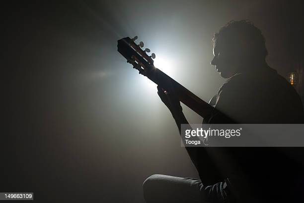 Guitarist playing instrument on stage