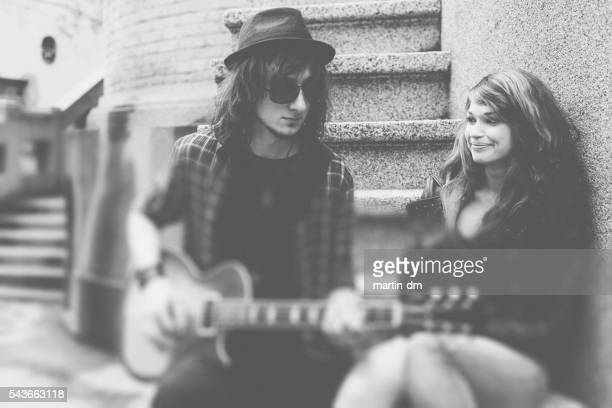 guitarist playing the guitar for his girlfriend - martin guitar stock photos and pictures