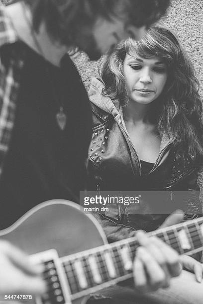 guitarist playing the guitar for his girlfriend - maxim musician stock photos and pictures