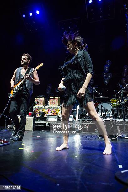 Guitarist Rich Koehler and vocalist Aja Volkman of Nico Vega perform at Gibson Amphitheatre on November 24 2012 in Universal City California